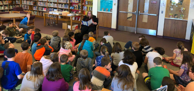 Prosecutor LaDonna Schutz reading to Rose City School Students - May 2018
