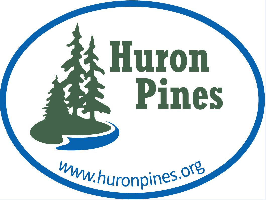 Huron Pines Logo with conifer trees